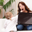 Mother and baby with laptop — Stock Photo #15638035