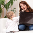 Mother and baby with laptop — Stock Photo #15638053