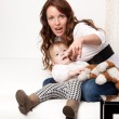 Young mother showing on something — Stock Photo
