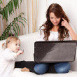 Mother and baby with laptop — Stock Photo