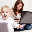 Stock Photo: Mother and baby with laptop