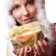 Christmas santa woman holding gift. — Stock Photo