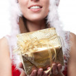 Stock Photo: Christmas santa woman holding gift.