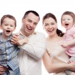 Happy young family with pretty child posing on white background — Stock Photo