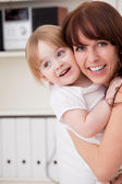 Mother and daughter at home — Stock Photo