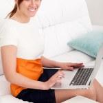 Woman prints on the laptop — Stock Photo