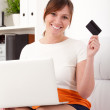 Closeup portrait of woman with a laptop and card — Stock Photo