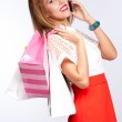 Woman with shopping bags talking on mobile — Stock Photo #24998097