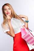 Woman with red lips and bag — Stock Photo