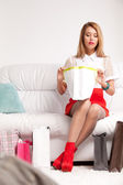 Woman looking into shopping bag — Stock Photo