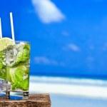 Cocktail mojito on beach — Stock Photo #25524333
