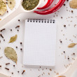 Spices, notebook, red chili pepper — Stock Photo #26517637