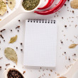 Spices, notebook, red chili pepper — Stock Photo