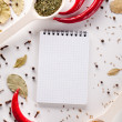Spices, notebook, red chili pepper — Stock Photo #26518203