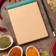 Old notebook, spices in spoons — Stock Photo