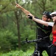 Couple riding bicycles outside — Stock Photo #28651319