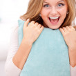 Smiling woman hugging pillow — Stock Photo
