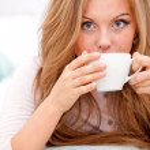 Woman drinking coffee, tea — Stock Photo
