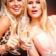 Stock Photo: Two women drinking champagne