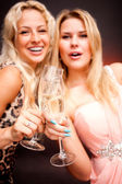 Two women drinking champagne — Stock Photo