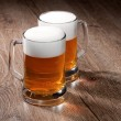 Two glass beer on wooden table — Stock Photo