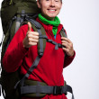 Full length portrait of a hiker with backpack posing isolated — Stock Photo #31672349