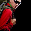 Young man with backpack walking — Stock Photo #31673951