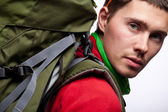 Bild av student med ryggsäck och bok i specifikationer — Stockfoto