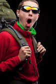 Young man with backpack walking — Stock Photo