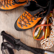 Stock Photo: Hiking boots with trekking poles