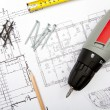 Stock Photo: Blueprints with tools