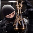 Stock Photo: Burglar wearing black mask