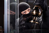 Burglar wearing black mask — Stock fotografie