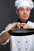 Supsised chef holding pan — Foto Stock