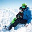 Young happy couple in snowy mountains. — Stock Photo #43134049