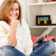 Smiling woman with tablet — Stock Photo