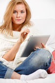 Thinking woman using tablet — Stock Photo