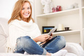 Woman relaxing with digital tablet — Stock Photo