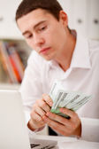 Man counting money — Stock Photo