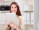Young woman with tablet — Stock Photo