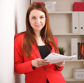 Woman holding sheaf of paperwork — Stock Photo