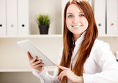 Woman using tab — Stock Photo