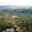 Stock Photo: Aerial landscape view of a rural area under blue sky. Moldova