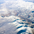 Aerial view of snow-covered mountains — ストック写真