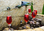 Fountain of red wine — Stock Photo