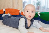 Baby in a baby cot — Stock Photo
