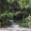 Постер, плакат: Artistic statues adorn the shady lane
