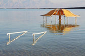 The beach pavilion is half flooded with seawater risen — Stock Photo