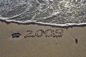 "The inscription on sand ""2009"" — Stock Photo"