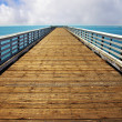 Wooden pier at Pacific coast - Foto Stock